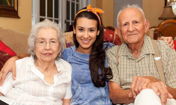 elderly couple with their caretaker