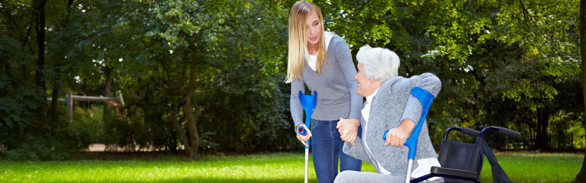 caretaker assisting an elderly woman