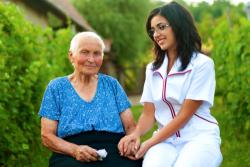 caregiver accompanying an elderly woman